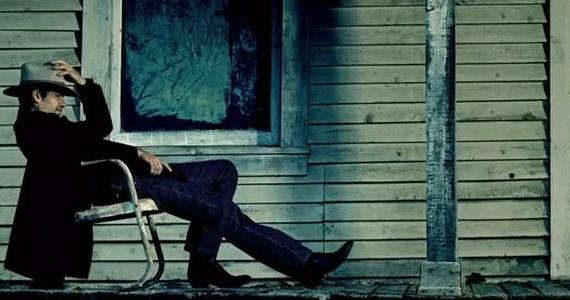 raylan on porch sitting