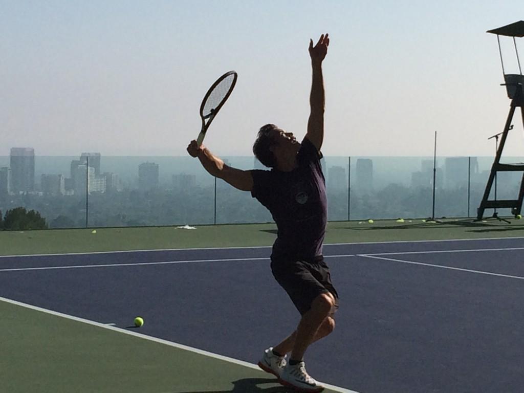 tim playing tennis mak