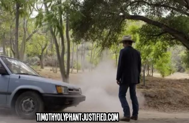 Raylan in front of car wth text Cash Game