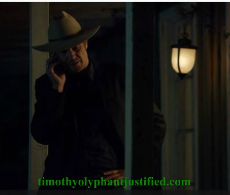 raylan on porch on phone