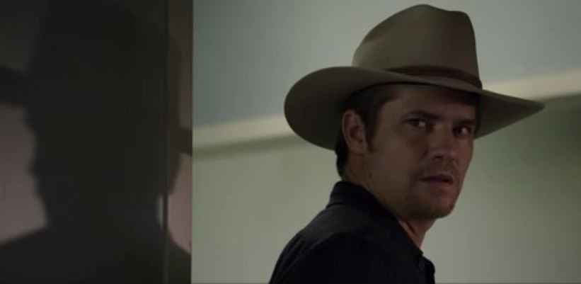 Raylan in doorway shadow