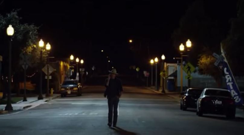 raylan walking down street
